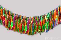This fabric garland is made from 4 100% cotton flour sack towels that are dyed then cut into strips.
