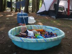 Make-do play area for baby. A baby pool makes a great play yard when camping with an infant.