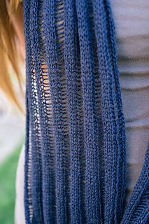 Lightweight and perfect for those warm summer evenings, the Alcea Cowl is a great accessory and a quick knit. There's just one simple set up row followed by simple stockinette until the end when key stitches are dropped and unraveled down the length of the cowl. This cowl is worked flat and seamed at the end so you can easily customize the length to suite your style.
