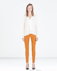 Image 1 of MEDIUM-RISE COATED SLIM-FIT TROUSERS from Zara