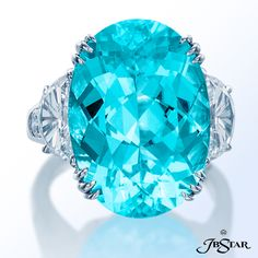 JB Star Beautiful oval paraiba ring featuring a 15.7 ct oval paraiba embraced by half moon and round diamonds. Platinum