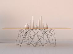 Quantum Table - Hands down the coolest dining table that I have seen thus far — and I have seen a lot of dining tables. The table base aims . Metal Furniture, Home Furniture, Furniture Design, Apartment Furniture, Modern Furniture, Dining Room Table, A Table, Table Bases, Table Legs