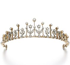 DIAMOND AND SEED PEARL NECKLACE/TIARA, LATE 19TH CENTURY.  Designed as an alternating series of floret motifs and knife-edge drops set with circular-cut diamonds and seed pearls, to a later chain, length approximately 195mm, detachable tiara fitting.