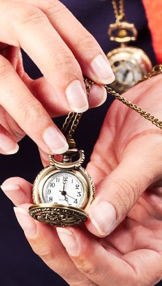 It's super simple, but to open these pocket watches, press down on the clock dial at the top. Then it pops open! Click to shut. That's it. (: Spread the word!