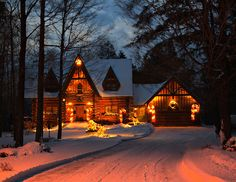 Lighted cottage in the snow