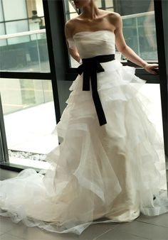 Yup. My wedding dress. Simple yet adorable. Romantic Organza Layered Chapel Train Wedding Dress.