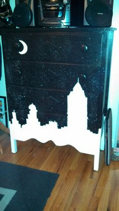 We took a free dresser off craigslist and painted it black with a city skyline for our NYC themed bedroom