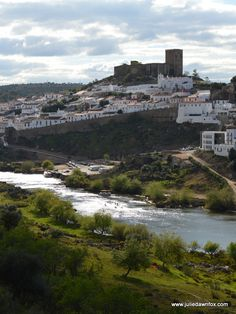 Medieval hilltop town and castle of Mértola and the Guadiana River in the Alentejo region of Portugal. Click to read more.