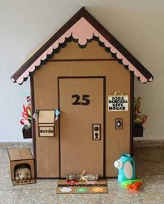 Make a sweet little gingerbread cardboard house, complete with a mailbox and doghouse!
