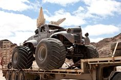 Road Warrior style vehicles.