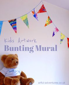 Use children's artwork to create a decorative bunting mural.