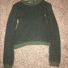 Green and black sweater. Really cute with low rise jeans or shorts. Extra long sleeves which is nice. Soft material. Macy's Sweaters Crew & Scoop Necks