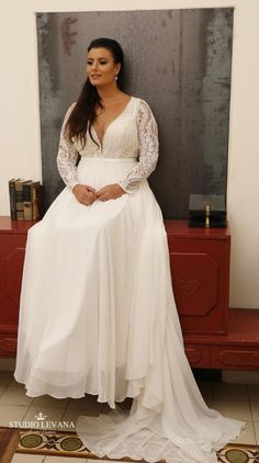 Bohemian plus size bridal gown with deep V neckline chiffon skirt and detachable long lace sleeves. Studio Levana Bohemian plus size bridal gown with deep V neckline chiffon skirt and detachable long lace sleeves. Corset Back Wedding Dress, Detachable Wedding Dress, Plus Size Wedding Dresses With Sleeves, Plus Size Wedding Gowns, Western Wedding Dresses, Plus Size Gowns, Bridal Dresses, Lace Wedding, Dress Lace