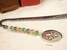 Hey, I found this really awesome Etsy listing at https://www.etsy.com/listing/464874992/beaded-bookmark-with-charm-fleur-de-lis