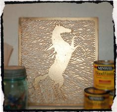 Beautiful horse string art. Golden background with a reverse image of a horse. The horse is outlined in white. Beautiful artwork for any horse or animal lover and will match with any decor.  Ready to hang with a sawtooth picture hanger.  Custom orders are offered on all pieces for sale.