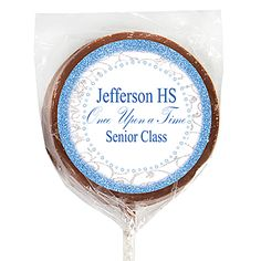 Our Dream Come True Milk Chocolate Lollipops feature a blue sparkly design with silver swirl accents.