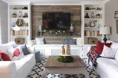 Christmas living room with bookcases converted into built-ins *Love the bench between the bookshelves*