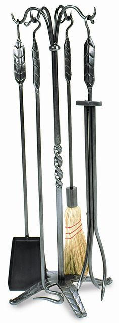 Features:  -Material: Wrought iron.  -Large leaf design.  -Set includes stand, poker, brush, shovel and tongs.  -Finish: Graphite powder coated.  Product Type: -Fireplace tool.  Finish: -Graphite powd