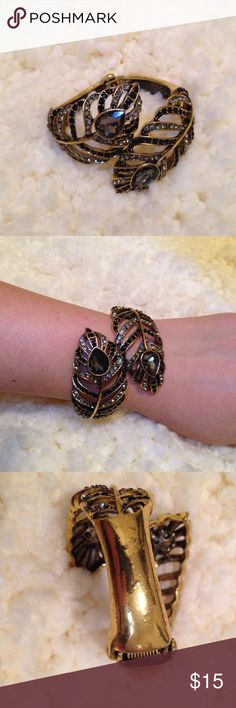 Black and gold bracelet Good condition, has some bubbling on it as seen in picture. Jewelry Bracelets