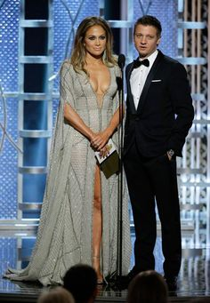 """Jeremy Renner and Jennifer Lopez presented the 2015 Golden Globe for Best Mini-Series/Drama, and while opening the envelope to announce the winner, Renner called out Lopez's cleavage. """"You want me to do it? I have the nails,"""" Lopez said before announcing the winner. """"You've got the globes, too,"""" Renner quipped. - US Weekly"""