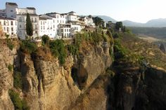 The crazy cliff-side dwellings of Ronda, Spain Ronda Malaga, Places Around The World, Around The Worlds, Vila Medieval, Andalucia Spain, Mix Photo, Holiday Resort, Toscana, Greek Isles