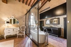 Look at this impressive design bathroom, part of a Renaissance Florentine palace designed by Brunelleschi: an elegant combination of both modern and ancient style creates the charming atmosphere of this sophisticated and prestigious property! #italia #italy #tuscany #toscana #firenze #florence #bathroom #luxury #luxuryliving #swag #glam #glamour #design #designfurniture #designideas #ideas #decor #white #bathtub #beauty #style #lifestyle #home #house #renaissance #property #renaissance #art…