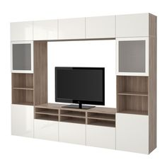 IKEA - BESTÅ, TV storage combination/glass doors, walnut effect light gray/Selsviken high-gloss/white frosted glass, drawer runner, push-open, , The drawer and doors have integrated push-openers, so you don't need handles or knobs and can open them with just a light push.This TV storage combination has plenty of extra storage and makes it easy to keep your living room organized.The space-saving wall cabinets make the most of the wall area above your TV.It's easy to keep the cords from your…