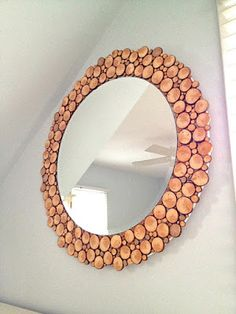 DIY Wood Slice Mirror Project: Create this rustic project by upcycling an old mirror and transforming it into beautiful home decor using wood slices and Elmer's Wood Glue.