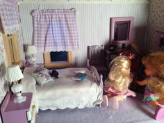 Playing with the dollhouse