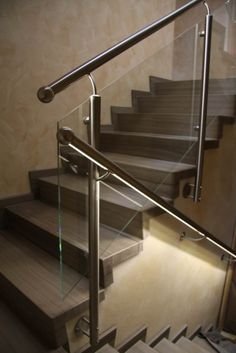 Stainless steel railing with a glass filling and a handrail with LED lighting