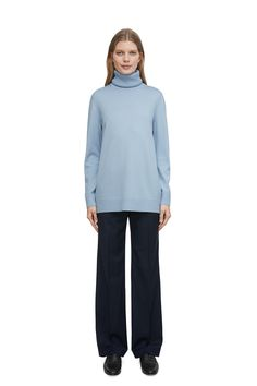 "<p style=""text-align: justify;"">Plain-knit with a ribbed roll-neck, this jumper has a slightly longer silhouette and a relaxed fit. The soft and lustrous or"