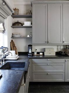 Dark Cabinets With Soapstone Countertops.Remodelaholic Decorating With Black: 13 Ways To Use Dark . Historic Farmhouse Renovation: Getting Ready For Our Big Move. Soapstone With Navy Blue Or Black Cabinets - Homchick . Home and Family Kitchen Black Counter, Grey Kitchen Cabinets, Light Grey Kitchens, Black Kitchens, Dream Kitchens, Dark Countertops, Kitchen Countertops, Soapstone Kitchen, Laminate Countertops