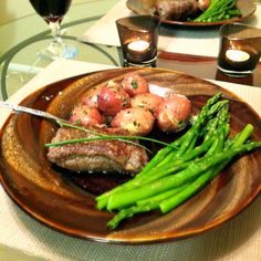 Butter n' chive garlic stuffed steaks with asparagus and garlic chive baby red potatoes!