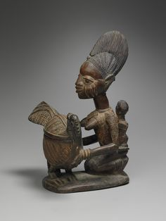Kneeling Maternity Figure with Bowl in the Form of a Chicken (Olumeye) - early 20th century. Wood and pigment. Made in Guinea Coast, Nigeria. Culture: Yoruba, Ekiti subgroup, possibly Efon-Alaye. | Copyright © 2015 The Yale University Art Gallery