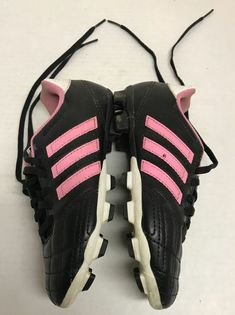 3e1a7c6d220 Here is a pair of Adidas youth soccer shoes with cleats. They are kid s size  They are style number ART They are pink and black and white with pink  stripes.
