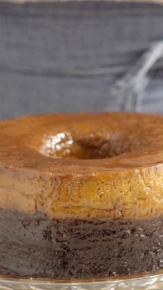 "Recipe with video instructions: This baked dessert is half cake, half ""pudim"" and completely delicious. Ingredients: 150 grams granulated sugar, 4 eggs + 1 egg yolk, 2 cups of sugar, Chocolate Flan Cake, Bolo Chocolate, Cookie Recipes, Dessert Recipes, Rhubarb Cake, Portuguese Recipes, Clean Eating Snacks, Sweet Recipes, Food And Drink"