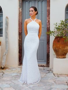 25015 - Emily - Sleek, sophisticated and a beautiful back! Try this beauty on at Aurora Bridal in Melbourne, FL (321)254-3880