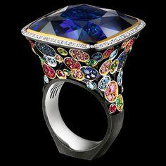18K white gold ~ 1 sapphire 54,82 ct  110 diamonds 0,35 ct  43 blue diamonds 0,40 ct  65 purple diamonds 0,54 ct  56 sapphires 0,58 ct  43 rubies 0,46 ct  47 tsavorites 0,47 ct  3 tourmalines 0,03 ct