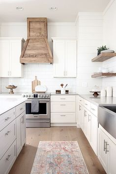Our white modern farmhouse kitchen with custom wood hood and floating shelves. Our white modern farmhouse kitchen with custom wood hood and floating shelves. Shaker Style Kitchen Cabinets, Shaker Style Kitchens, Kitchen Cabinet Styles, Farmhouse Kitchen Cabinets, Modern Farmhouse Kitchens, Kitchen Cabinetry, Cool Kitchens, Farmhouse Ideas, Kitchen Modern