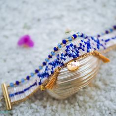 Our Bohemian inspired friendship bracelets are an eclectic mix of fine chains, beautiful glass crystal beads and bead loom work, made using an ancient Native American beading technique. Resort, inspired by breezy tropical resort ware, is made with a detailed glass bead loom, 14k gold filled chain, silk thread tassels, and quality glass crystal beads.