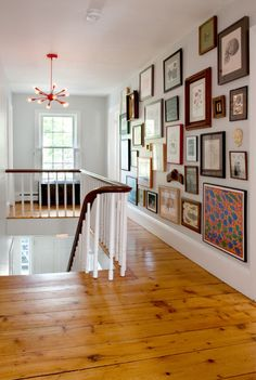 gallery wall - i like the mix of patterns and prints with family photos