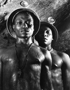 Margaret Bourke-White: Gold Miners, Johannesburg, South Africa, 1950    At the end of 1949, LIFE magazine sent Margaret Bourke-White on assignment to South Africa for a few months. There, in a gold mine near Johannesburg, at a depth of nearly 5000 feet (1500 m) and in blistering heat, she made the photograph of the two black miners drenched in sweat - a photograph that she herself declared to be one of her favourite pictures.