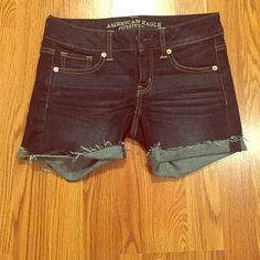 American Eagle Midi shorts These shorts are dark denim. Super stretchy and comfy material. Never worn, perfect condition American Eagle Outfitters Shorts Jean Shorts