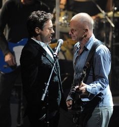 Robert Downey Jr. sings with Sting onstage (Sting's 60th birthday celebration at the Beacon, NYC, 2011).