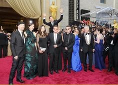 This is a thing that happened. | Benedict Cumberbatch Photobombed U2 On The Oscars Red Carpet