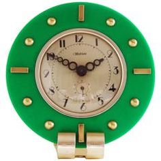 Stunning French Art Deco Green Lucite, Aluminium & Brass Mechanical Alarm Clock | From a unique collection of antique and modern clocks at https://www.1stdibs.com/furniture/decorative-objects/clocks/