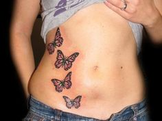 Nicely Placed Stomach Tattoo Photos From Revolver Tattoo Rooms