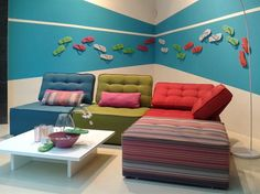Modern, colourful sofa... versatile too as it can be positioned to suit corners as well as long spaces.