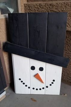 Here's a great DIY up-cycle project of a snowman and scarecrow porch decoration. It can be made from some leftover wood and paint, adding a dual-season, festive touch to your home.