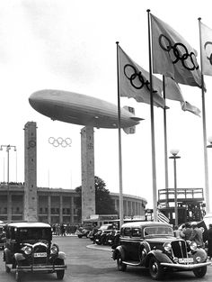 The Hindenburg over Berlin in 1936. It is flying over the Reichssportfeld (now known as Olympiastadion) that was built for the 1936 Summer Olympics.